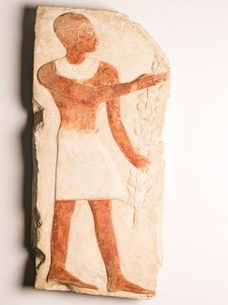 Relief of a standing man
